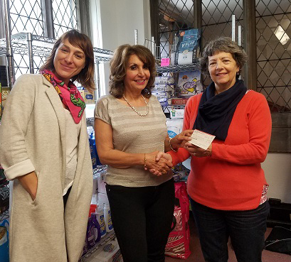 pictured left to right are Natalie Surmeli, Executive Director, Mawya Shocair, M.D., President Charles River District and Amy McGregor-Radin, Vice President, Centre St. Food Pantry